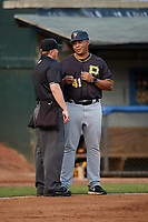 Bristol Pirates manager Miguel Perez (41) talks with home plate umpire Adam Clark during a game against the Bluefield Blue Jays on July 26, 2018 at Bowen Field in Bluefield, Virginia.  Bristol defeated Bluefield 7-6.  (Mike Janes/Four Seam Images)