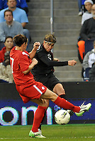 USWNT midfielder Amy LePeilbet (6) gets a cross in pass Canada defender Rhian Wilkinson.