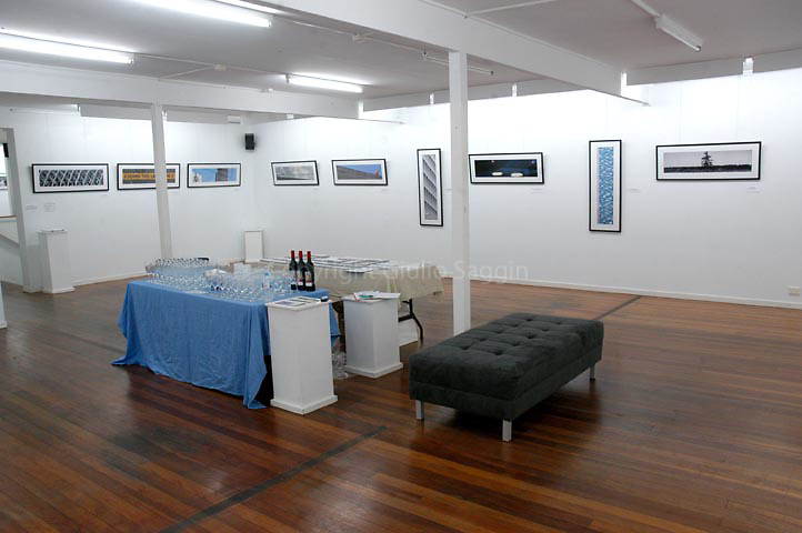 The main room/gallery space with Giulio's photos on the afternoon of the opening night.
