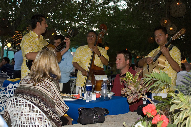 Musicians playing for a couple dining at La Golondrina restraunt, Cabo San Lucas, Baja California, Mexico
