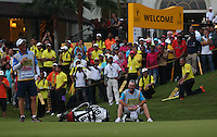 A deserved sit down for Lee Westwood's caddie Billy Foster at the last hole during the Final Round of the 2014 Maybank Malaysian Open at the Kuala Lumpur Golf & Country Club, Kuala Lumpur, Malaysia. Picture:  David Lloyd / www.golffile.ie