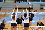 10 September 2015: Stanford's Sidney Brown (11) hits over North Carolina's Taylor Treacy (20) and Paige Neuenfeldt (left). The University of North Carolina Tar Heels hosted the Stanford University Cardinal at Carmichael Arena in Chapel Hill, NC in a 2015 NCAA Division I Women's Volleyball contest. North Carolina won the match 25-17, 27-25, 25-22.