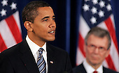 "Chicago, IL - December 11, 2008 -- United States President-elect  Barack Obama speaks at a news conference introducing nominee Tom Daschle as his Secretary of Health and Human Services director, right Thursday December 11, 2008, in Chicago, Illinois. In his remarks, Obama said he was ""appalled and disappointed"" by the revelations this week concerning Illinois Governor Rod Blagojevich's alleged attempts to sell Obama's old United States Senate seat..Credit: Frank Polich - Pool via CNP"