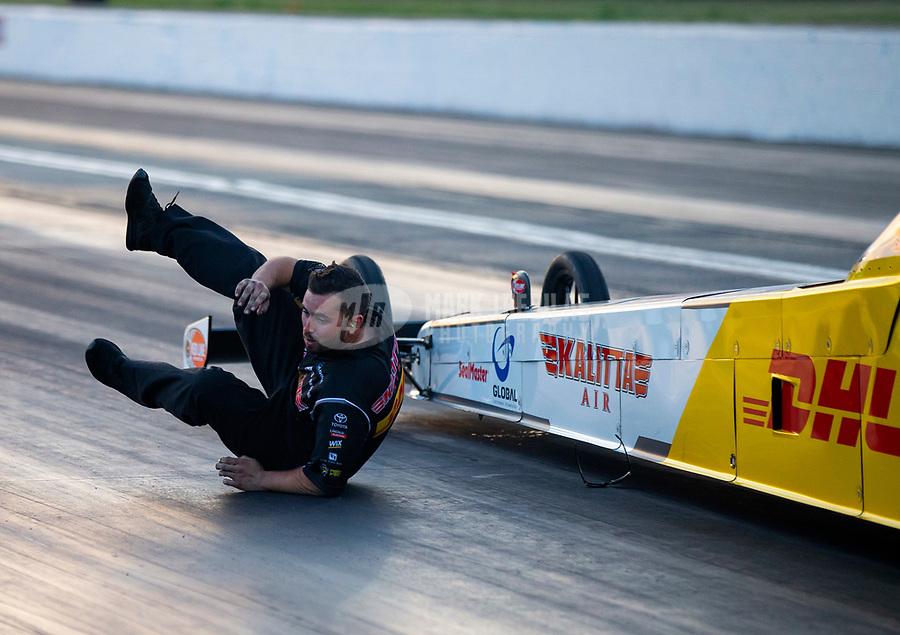 May 4, 2018; Commerce, GA, USA; Crew member for NHRA top fuel driver Richie Crampton falls during qualifying for the Southern Nationals at Atlanta Dragway. Mandatory Credit: Mark J. Rebilas-USA TODAY Sports