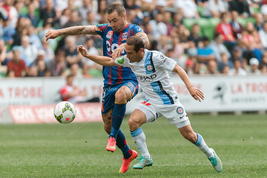 Jonny STEELE of the Jets and Massimo MURDOCCA of Melbourne City fight for the ball in the round 2 match between Melbourne City and Melbourne Victory in the Australian Hyundai A-League 2014-15 season at AAMI Park, Melbourne, Australia.