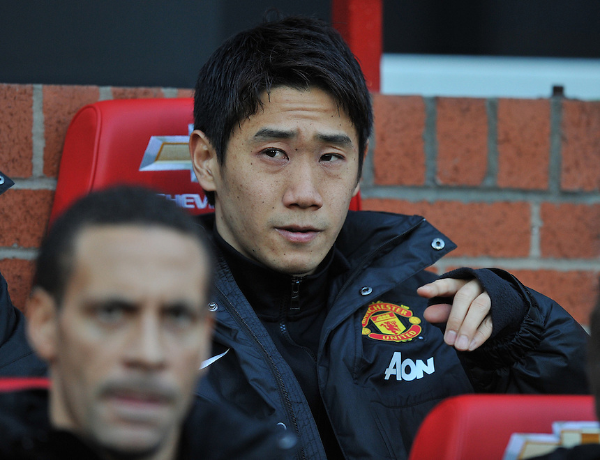 Manchester United's Shinji Kagawa takes his place on the bench before kick off<br /> <br /> Photo by Dave Howarth/CameraSport<br /> <br /> Football - Barclays Premiership - Manchester United v Fulham - Sunday 9th February 2014 - Old Trafford - Manchester<br /> <br /> &copy; CameraSport - 43 Linden Ave. Countesthorpe. Leicester. England. LE8 5PG - Tel: +44 (0) 116 277 4147 - admin@camerasport.com - www.camerasport.com