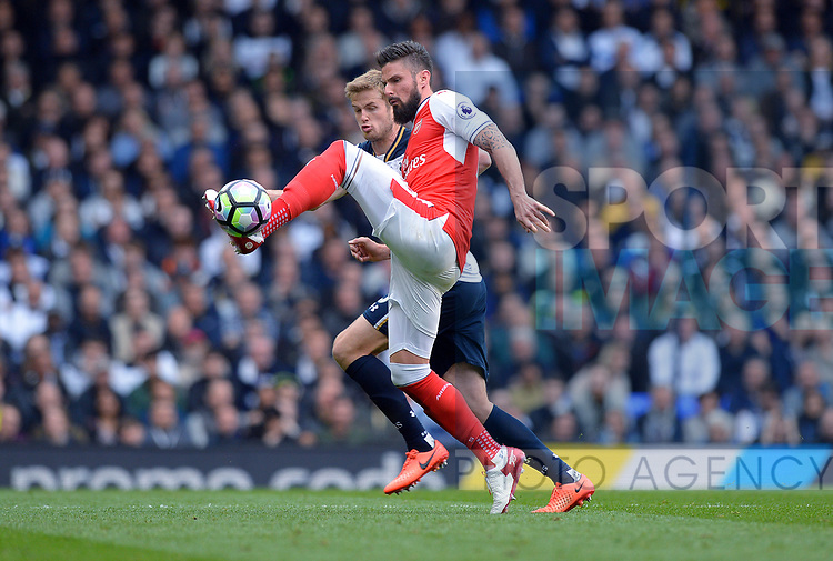 Olivier Giroud of Arsenal is challenged by Eric Dier of Tottenham Hotspur during the English Premier League match at the White Hart Lane Stadium, London. Picture date: April 30th, 2017.Pic credit should read: Robin Parker/Sportimage