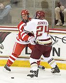 Adam Clendening (BU - 4), Bill Arnold (BC - 24) - The Boston College Eagles defeated the visiting Boston University Terriers 5-2 on Saturday, December 4, 2010, at Conte Forum in Chestnut Hill, Massachusetts.