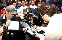Montreal, June 5th 2001<br /> <br /> BAR team Formula One driver, JACQUES VILLENEUVE sign autographs for fans, June 5th 2001,<br />  in front of his new restaurant - dance club ``Newtown`` on Crescent Street in downtown MONTREAL , Canada.<br /> Photo by Pierre Roussel / Getty Images (On spec.)<br /> NOTE : Nikon D-1 TIFF open with QImage ICC profile, save in Adobe 1998 RGB color space.