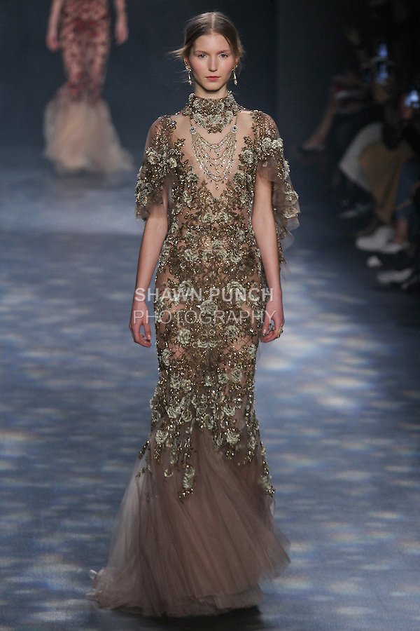 Model Paula walks runway in a mocha tulle fishtail gown with cape sleeves embellished in antique gold and bronaze floral embroidery, from the Marchesa Fall 2016 collection by Georgina Chapman and Keren Craig, presented at NYFW: The Shows Fall 2016, during New York Fashion Week Fall 2016.