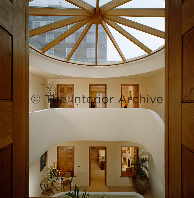 Light pours into this mews house from a large circular skylight above the curved staircase
