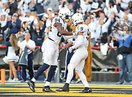 College Park, MD - November 25, 2017: Penn State Nittany Lions quarterback Trace McSorley (9) and Penn State Nittany Lions wide receiver Juwan Johnson (84) celebrates after a touchdown during game between Penn St and Maryland at  Capital One Field at Maryland Stadium in College Park, MD.  (Photo by Elliott Brown/Media Images International)