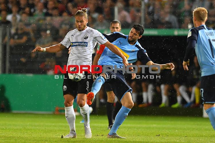 09.08.2019, BWT-Stadion am Hardtwald, Sandhausen, GER, DFB Pokal, 1. Runde, SV Sandhausen vs. Borussia Moenchengladbach, <br /> <br /> DFL REGULATIONS PROHIBIT ANY USE OF PHOTOGRAPHS AS IMAGE SEQUENCES AND/OR QUASI-VIDEO.<br /> <br /> im Bild: Rurik Gislason  (#9, SV Sandhausen) gegen Tobias Strobl (#5, Borussia Moenchengladbach)<br /> <br /> Foto © nordphoto / Fabisch