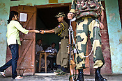 Local villagers cast their vote amidst high security in the polling station in Moirang, Manipur, India. About 62 per cent of 8,02,000 voters exercised their franchise in an incident-free secondphase of Lok Sabha elections for the prestigious Inner Manipur parliamentary constituency on April 22nd 2009.