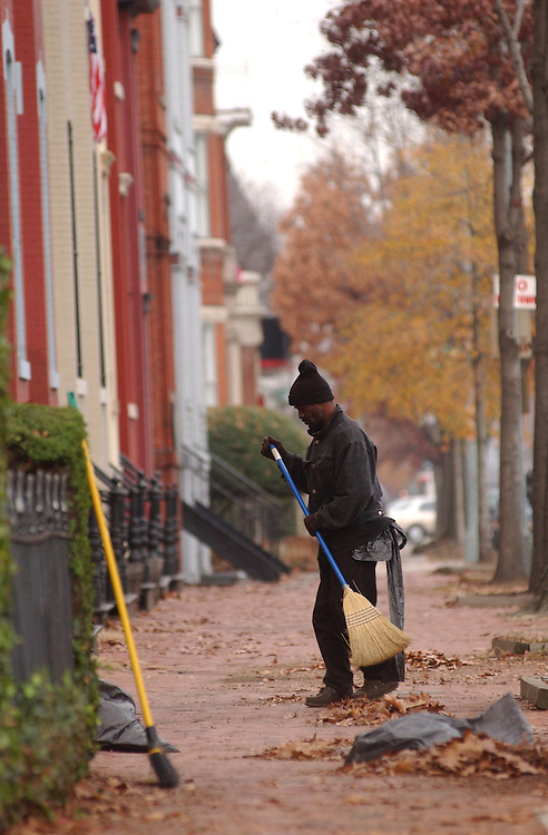 sweep112701 - Anthony Chisley sweeps up leaves on Pennsylvania Avenue, SE.