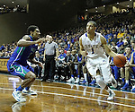 SIOUX FALLS, SD - NOVEMBER 30:  Skyler Flatten #1 from South Dakota State University drives against Julian DeBose #3 from Florida Gulf Coast in the second half of their game Sunday afternoon at the Sanford Pentagon in Sioux Falls. (Photo by Dave Eggen/inertia)