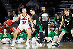 SIOUX FALLS, SD - MARCH 8: Tyler Hagedorn #25 of the South Dakota Coyotes attempts to drive to the basket against Kienan Walter #23 of the North Dakota Fighting Hawks at the 2020 Summit League Basketball Championship in Sioux Falls, SD. (Photo by Richard Carlson/Inertia)