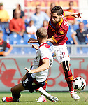 Calcio, Serie A: Roma-Bologna. Roma, stadio Olimpico, 16 settembre 2012..AS Roma forward Mattia Destro is challenged by Bologna defender Mikael Antonsson, of Sweden, left, during the Italian Serie A football match between AS Roma and Bologna, at Rome, Olympic stadium, 16 September 2012. .UPDATE IMAGES PRESS/Isabella Bonotto