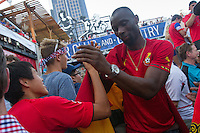 Kansas City, MO - Monday, June 16, 2014: A USA soccer fan shares a handshake with a Ghana soccer fan after watching the USA vs. Ghana first round World Cup match at a public viewing in the Power and Light District of Kansas City, Missouri.