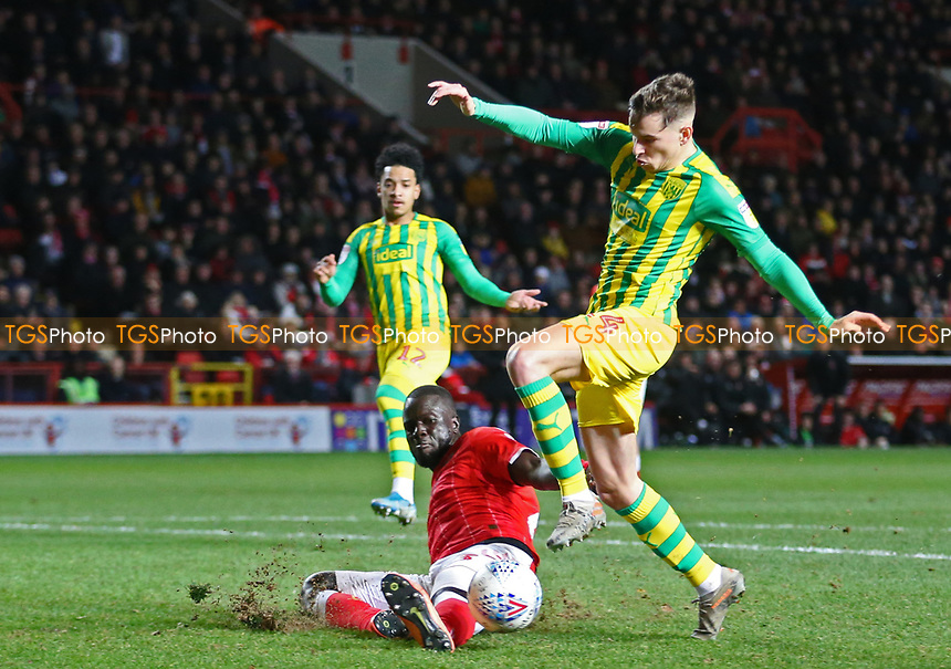 Mouhamadou-Naby Sarr of Charlton Athletic blocks Conor Townsend of West Bromwich Albion shot during Charlton Athletic vs West Bromwich Albion, Sky Bet EFL Championship Football at The Valley on 11th January 2020