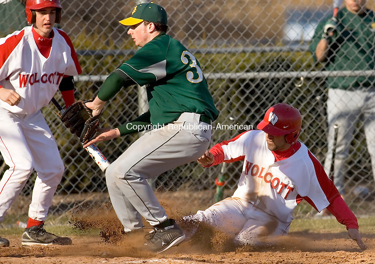 WOLCOTT, CT--09 APRIL 2007--040907JS11-Wolcott's Nick Negretti is safe at home as he comes in from third on a wild pitch while Holy Cross' Kyle Murphy covers the plate during their game against Holy Cross Monday at the BAW complex in Wolcott.<br /> Jim Shannon / Republican-American