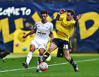 Liam Shephard of Swansea and Chris Maguire of Oxford United   during the Emirates FA Cup 3rd Round between Oxford United v Swansea     played at Kassam Stadium  on 10th January 2016 in Oxford