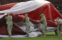 A giant Stars and Stripes is rolled up after the Star Spangled Banner before the start of  an NCAA football game between the Ohio State Buckeyes and the Minnesota Golden Gophers at Ohio Stadium on Saturday, November 7, 2015. (Columbus Dispatch photo by Fred Squillante)