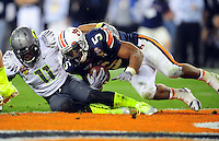 Jan 10, 2011; Glendale, AZ, USA; Auburn Tigers running back Michael Dyer (5) is tackled short of the goal line by Oregon Ducks safety Eddie Pleasant (11) during the fourth quarter of the 2011 BCS National Championship game at University of Phoenix Stadium.  Mandatory Credit: Mark J. Rebilas-