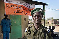 A policewoman stands guard outside a referendum centre in Bentiu. In January 2011 South Sudan will vote in a referendum on independence.