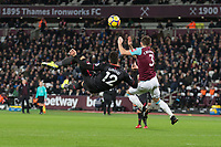 Olivier Giroud of Arsenal goes for a overhead shot at goal during the Premier League match between West Ham United and Arsenal at the Olympic Park, London, England on 13 December 2017. Photo by Andy Rowland.