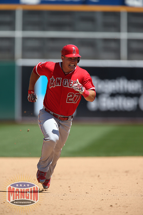 OAKLAND, CA - APRIL 30:  Mike Trout #27 of the Los Angeles Angels runs the bases against the Oakland Athletics during the game at O.co Coliseum on Thursday, April 30, 2015 in Oakland, California. Photo by Brad Mangin