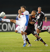 San Jose Earthquakes midfielder Chris Wondolowski (8) kicks the ball while cover from behind by DC United defender Jordan Graye (16).  San Jose Earthquakes defeated DC United 2-0 at RFK Stadium, October 9, 2010.