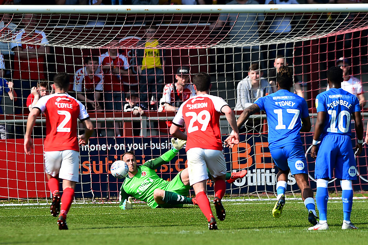 Fleetwood Town's Alex Cairns saves the penalty kick of Peterborough United's Marcus Maddison<br /> <br /> Photographer Richard Martin-Roberts/CameraSport<br /> <br /> The EFL Sky Bet League One - Fleetwood Town v Peterborough United - Friday 19th April 2019 - Highbury Stadium - Fleetwood<br /> <br /> World Copyright © 2019 CameraSport. All rights reserved. 43 Linden Ave. Countesthorpe. Leicester. England. LE8 5PG - Tel: +44 (0) 116 277 4147 - admin@camerasport.com - www.camerasport.com