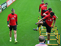 (L-R) Gareth Bale, Ben Davies, Sam Vokes, Joe Allen and Ashley Williams warm up during the Wales Training Session at the Vale Resort, Hensol, Wales, UK. Tuesday 29 August 2017