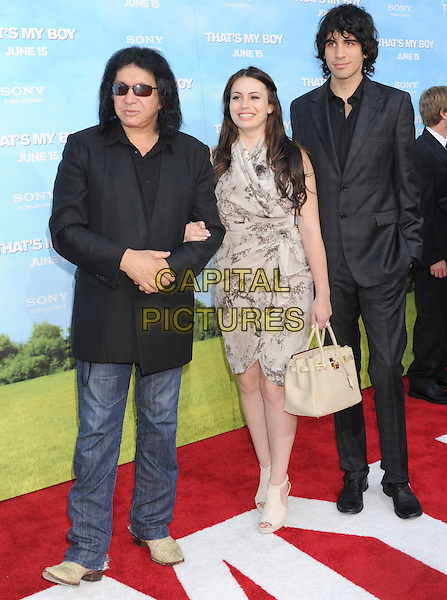 "Gene Simmons, Sophie Simmons, Nick Simmons.The Los Angeles premiere of ""That's My Boy"" at Regency Village Theatre in Westwood, California, USA..June 4th, 2012 .full length jacket jeans denim black sunglasses shades beige grey gray print dress father dad son daughter kids children family .CAP/ROT/TM.©Tony Michaels/Roth Stock/Capital Pictures"