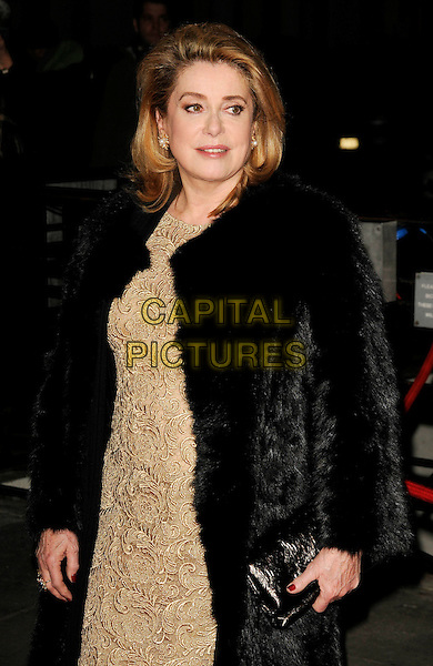 CATHERINE DENEUVE .At the Cine Lumiere Gala re-opening, Institut Francais, Queensbury PLace, London, England, 9th January 2008..half length black coat gold dress fur clutch bag .CAP/CAN.©Can Nguyen/Capital Pictures