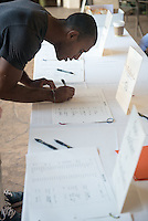 Occidental College incoming first-year Raul Soto '18 signs the register as part of matriculation during Orientation, August 26, 2014 at the Samuelson Alumni Center. (Photo by Marc Campos, Occidental College Photographer)