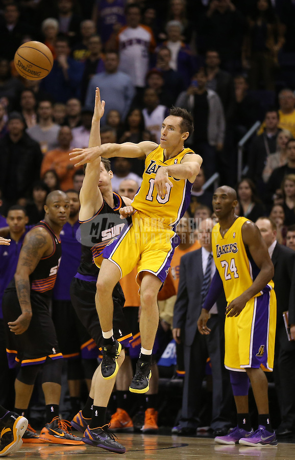 Jan. 30, 2013; Phoenix, AZ, USA: Los Angeles Lakers guard Steve Nash passes the ball in the second half against the Phoenix Suns at the US Airways Center. The Suns defeated the Lakers 92-86.  Mandatory Credit: Mark J. Rebilas-
