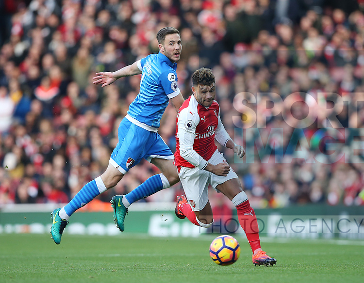 Arsenal's Alex Oxlade-Chamberlain tussles with Bournemouth's Dan Gosling during the Premier League match at the Emirates Stadium, London. Picture date October 26th, 2016 Pic David Klein/Sportimage