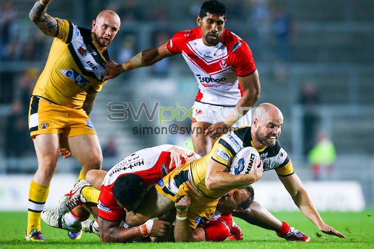 Picture by Alex Whitehead/SWpix.com - 19/09/2014 - Rugby League - First Utility Super League Play-off - St Helens v Castleford Tigers - Langtree Park , St Helens, England - Castleford's Liam Finn is tackled by St Helens' Mose Masoe and James Roby.