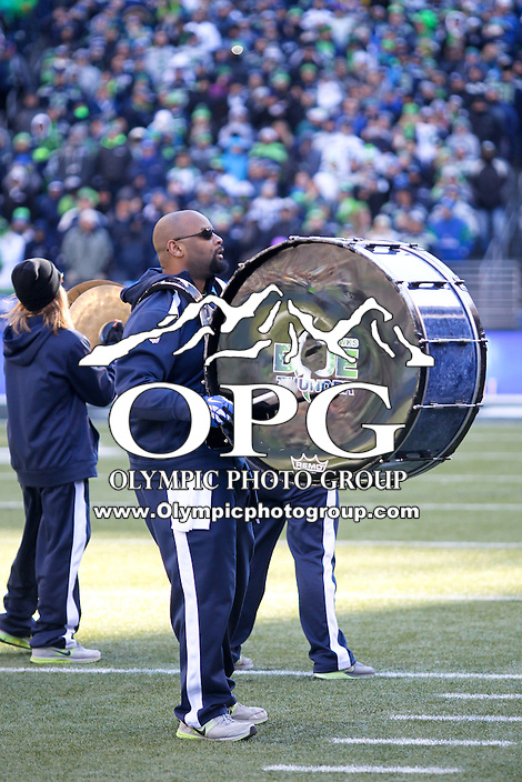 2014-02-05:  Blue Thunder band members entertained fans at the start of the Super Bowl celebration. Seattle Seahawks players and 12th man fans celebrated bringing the Lombardi trophy home to Seattle during the Super Bowl Parade at Century Link Field in Seattle, WA.