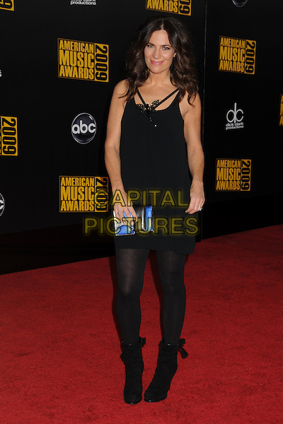 ROBERTA ARMANI. 2009 American Music Awards - Arrivals held at the Nokia Theatre L.A. Live, Los Angeles, California, USA..November 22nd, 2009.AMA AMA's full length dress tights boots blue clutch bag black dragonfly pink brooch.CAP/ADM/BP.©Byron Purvis/AdMedia/Capital Pictures.