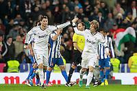 ATENCAO EDITOR IMAGEM EMBARGADA PARA VEICULOS INTERNACIONAIS - MADRI, ESPANHA, 16 DEZEMBRO 2012 - CAMP. ESPANHOL - REAL MADRID - ESPANYOL - Cristiano Ronaldo (D) comemora seu gol com Luka Modric jogador do Real Madrid durante partida contra o Espanyol pela 16 rodada do Campeonato Espanhol, no Estadio Santiago Bernabeu em Madri, capital da Espanha. A partida terminou 2 a 2. (FOTO: CESAR CEBOLLA / ALFAQUI / BRAZIL PHOTO PRESS).