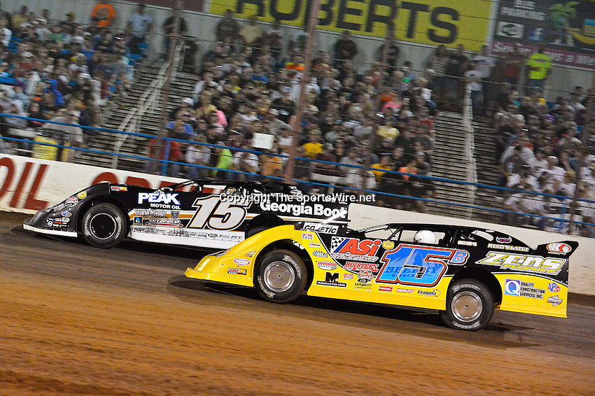 May 25, 2013; 10:19:07 PM; Wheatland, Mo., USA; The  Lucas Oil Late Model Dirt Series running the 21st Annual Lucas Oil Show-Me 100 Presented by ProtectTheHarvest.com.  Mandatory Credit: (thesportswire.net)