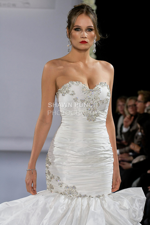 Model walks runway in a Bijou bridal gown from the Katerina Bocci 2013 collection, at the Couture Runway Show, during New York Bridal Fashion Week at The Hilton Hotel, October 13, 2012.