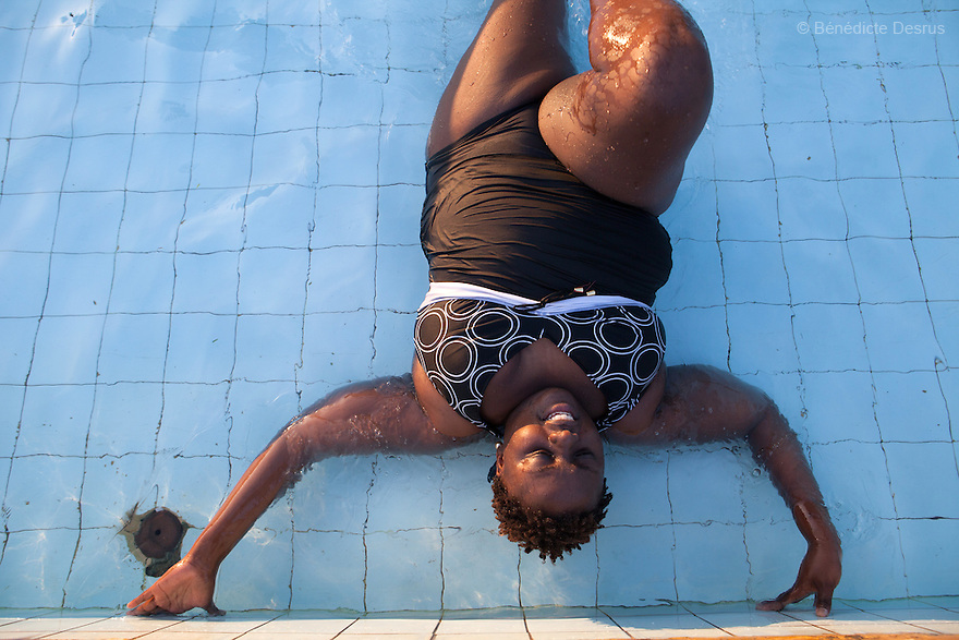 """Ruth does swimming workouts with AliceOjwang-Ndong, her nutritionist and dietetic consultant in Nairobi, Kenya on December 11, 2012. Ruth Gathu is a 35 year-old Kenyan woman who works as an office administrator. She weighs 299 pounds and weighs 175 centimeters, with a BMI of 44.3. She says: """"In Kenya, people don't spend money on nutrition programs""""…""""Obesity is in all the social class in Kenya, the rich, the middle class and the poor."""" Nairobi has a high prevalence of overweight and obesity among women, especially those in the middle and upper class. Like elsewhere in the world, the main drivers of obesity in Kenya are rapid urbanization and westernization, that have resulted in changing lifestyles such as increased consumption of """"unhealthy diets"""" and adoption of sedentary lifestyles. Photo by Bénédicte Desrus"""