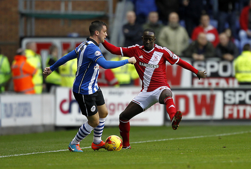 Middlesbrough's Albert Adomah battles with  Wigan Athletic's Andrew Taylor<br /> <br /> Photographer Mick Walker/CameraSport<br /> <br /> Football - The Football League Sky Bet Championship - Wigan Athletic v Middlesbrough - Saturday 22nd November 2014 - DW Stadium - Wigan<br /> <br /> &copy; CameraSport - 43 Linden Ave. Countesthorpe. Leicester. England. LE8 5PG - Tel: +44 (0) 116 277 4147 - admin@camerasport.com - www.camerasport.com