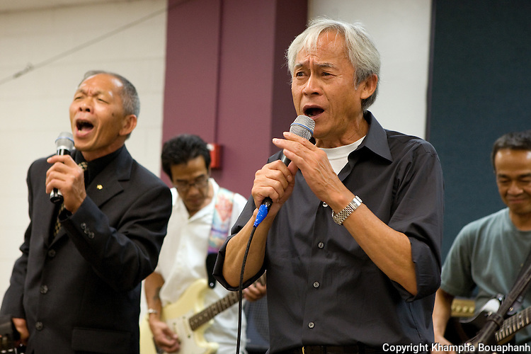 Voradeth Ditthavong, right, and Silavong Keo perform during the first annual Lao Artists Festival in Elgin, IL on August 21, 2010.  (photo by Khampha Bouaphanh)
