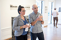Allegra Padilla, Coordinator of Community Programs and Bear Guerra.<br /> Opening Reception for South of Fletcher: Stories from the Bowtie, Sept. 13, 2018 at the Weingart Gallery. South of Fletcher: Stories from the Bowtie is a multi-platform storytelling project by Fonografia Collective, produced by Clockshop. Ruxandra Guidi and Bear Guerra have been working at the Bowtie parcel for the past year, talking to people who frequent the site, and learning more about the historic, present day, and potential uses of this unique plot of land next to the LA River. Their research will unfold through a podcast series, three public discussions, and an exhibition of photography at Occidental College. Sponsored by Oxy Arts.<br /> (Photo by Marc Campos, Occidental College Photographer)