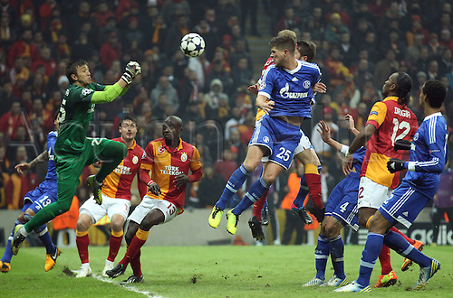 20.02.2013. Istanbul, Turkey.  Galatasaray's goalkeeper Fernando Muslera (L) and Klaas-Jan Huntelaar (C-R) of Schalke challenge for the ball during the UEFA Champions League round of 16 first leg soccer match between Galatasaray Istanbul and FC Schalke 04 at Ali Sami Yen Spor Kompleksi stadium in Istanbul, Turkey.